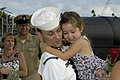 US Navy 030811-N-1618Z-064 Petty Officer Caldwell, stationed aboard USS Los Angeles (SSN 688), is greeted by his family after returning from a six month Western Pacific deployment.jpg