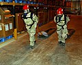 US Navy 041103-N-9563N-501 Members assigned to Naval Support Activity (NSA) Bahrain's Emergency Response Team (ERT) extract casualties during a simulated Chemical, Biological, Radiological (CBR) attack training exercise.jpg
