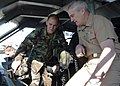 US Navy 050204-N-7949W-001 Special Warfare Combatant-craft Crewman (SWCC) and Boat Captain, Quartermaster 2nd Class Cliff Byrd, left, explains to Vice Chief of Naval Operations (VCNO) Adm. John Nathman, the various crew station.jpg