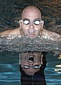 US Navy 050423-N-3527B-023 Lt. Cmdr. Scott Swope assigned to Explosive Ordnance Disposal Mobile Unit Ten (EODMU-10) swims his Physical Fitness Assessment (PFA) at the Special Warfare Center Pool onboard Naval Amphibious Base Li.jpg