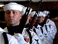 US Navy 050623-N-0555B-060 Members of the ceremonial honor guard stand at port arms during a burial at sea memorial in the hangar bay aboard the Nimitz-class aircraft carrier USS Ronald Reagan (CVN 76).jpg