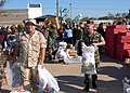 US Navy 051026-N-9583M-002 Active duty personnel carry bags of food and toiletries given to them by the Navy Exchange.jpg