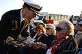US Navy 051111-N-5060B-131 Commanding Officer, USS Ronald Reagan (CVN 76), Capt. James Symonds, presents Sybil Stockdale, widow of Retired Adm. James Stockdale, with a memorial grave placard.jpg