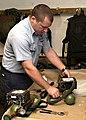 US Navy 060104-N-6205H-002 Aircrew Survival Equipmentman 2nd Class Jason Corse, inspects an Oxygen Walk Around Bottle that belongs to a P-3C Orion.jpg