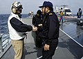 US Navy 060322-N-5837R-022 Commander Destroyer Squadron Nine (CDS-9) Capt. Jeffrey Harley, bids farewell to Cruiser Destroyer Squadron Six One (CDS-61) Capt. Katsuaki Amakawa, aboard JDS Kirishma (DDG 174).jpg
