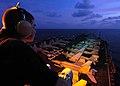US Navy 060511-N-7981E-083 Operations Specialist Seaman Kyle Wilson stands watch on the signal bridge aboard the Nimitz-class aircraft carrier USS Abraham Lincoln (CVN 72).jpg
