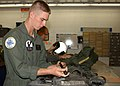 US Navy 061101-N-1810F-004 Aviation Electronics Technician Airman Apprentice Aaron G. Ferchland assigned to Patrol Squadron Three Zero (VP-30) inspects his survival gear before a training flight.jpg