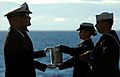 US Navy 070130-N-0555B-095 The remains of Senior Chief Aviation Machinist's Mate Gilberto Gordils Jr. pass from one Sailor to the next before they are committed to the ocean during a burial at sea ceremony held on board USS Ron.jpg