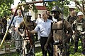 US Navy 070627-N-3642E-559 Secretary of the Navy (SECNAV) The Honorable Dr. Donald C. Winter looks at a swing set being repaired by Seabees.jpg