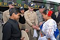 US Navy 070812-N-8704K-280 Capt. Bob Kapcio, mission commander for the Military Sealift Command (MSC) hospital ship USNS Comfort (T-AH 20), presents Alvako Coello and Lupita Carrion with commemorative mission coins after perfor.jpg