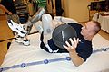 US Navy 071015-N-5086M-211 Air Force Capt. David K. Berling performs abdominal training with a medicine ball during routine therapy in the new Comprehensive Combat and Complex Casualty Care (C5) at Naval Medical Center San Dieg.jpg