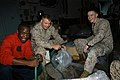 US Navy 071129-N-5642P-011 Sailors and Marines aboard the amphibious assault ship USS Kearsarge (LHD 3) fill water bags for distribution to the victims of Tropical Cyclone Sidr in Bangladesh.jpg