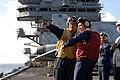 US Navy 080710-N-1635S-007 Boatswain's Mate 2nd Class Darrell Mccall, left, of Seguin, Texas, communicates to Gunner's Mate 2nd Class Anthony Castaneda, of Huntington Beach, Calif.jpg