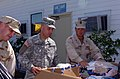 US Navy 080919-A-8772R-039 Army Staff Sgt. Difred Pascual and Navy Petty Officer 1st Class Christopher Thompson load a box of goods.jpg