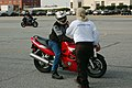 US Navy 081015-N-1081M-005 Carl Bennett, an instructor with Cape Fox Professional Services, discusses sports bike handling techniques with a Sailor during a sports bike safety course at Naval Station Anacostia.jpg