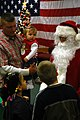 US Navy 081211-N-7367K-006 Construction Mechanic 3rd Class Robert Davies introduces his daughter to Santa Claus.jpg