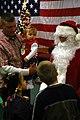 US Navy 081211-N-7367K-006 Construction Mechanic 3rd Class Robert Davies introduces his daughter to Santa Claus.jpg
