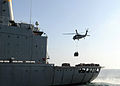 US Navy 090405-N-6814F-205 An MH-60S Seahawk helicopter lifts a load of supplies from the Military Sealift Command fleet replenishment oiler USNS Walter S. Diehl (T-AO 193).jpg