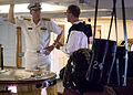 US Navy 090704-N-0167W-046 Cryptologic Technician 2nd Class Jake Wallace, assigned to USS Constitution, describes the Old Ironsides gun deck to Vice Admiral Kevin McCoy, commanding officer Naval Sea Systems Command during the s.jpg