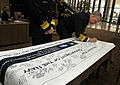 US Navy 100203-N-8273J-021 Chief of Naval Operations (CNO) Adm. Gary Roughead signs a banner at the wounded warrior hiring and support conference.jpg
