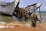 US Navy 100406-N-7948C-337 U.S. Marines assigned to Security Cooperation Marine Air-Ground Task Force (SC-MAGTF) disembark Landing Craft Utility (LCU) 1660.jpg