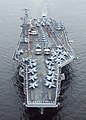 US Navy 100703-N-6720T-047 Sailors aboard aircraft carrier USS George Washington (CVN 73) spell out George Washington on the flight deck while arriving in port to commemorate the ships 18 years of Naval service.jpg