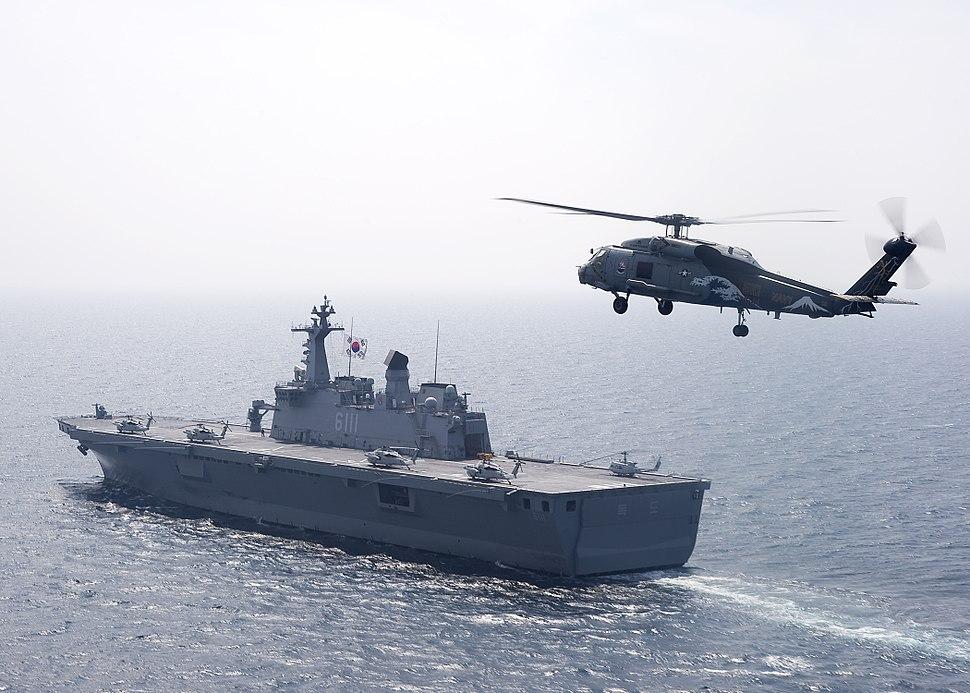 US Navy 100727-N-2013O-128 An SH-60F Sea Hawk helicopter flies by Dokdo (LPH 6111)