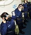 US Navy 100822-N-0569K-011 Sailors from an emergency response team don an MCU-2P gas mask during a drill aboard USS Enterprise (CVN 65).jpg