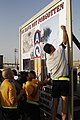 US Navy 100911-N-9958G-005 Cmdr. Kenneth Whitwell, right, puts his name on the banner promoting the 9.11 kilometer commemorative run at Camp Arifja.jpg