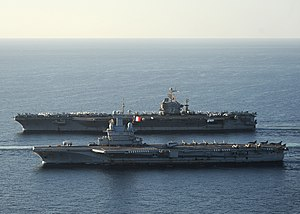 US Navy 101210-N-1261P-028 The aircraft carrier USS Abraham Lincoln (CVN 72), back, and the French navy aircraft carrier Charles De Gaulle (R 91) a.jpg
