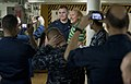 US Navy 110211-N-7981E-070 Comedian Gallagher poses with Sailors during an autograph signing on the mess decks of the Nimitz-class aircraft carrier.jpg