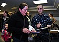 US Navy 110324-N-4044H-012 Yeoman 2nd Class Stephan Schreiber assists a Navy spouse with her travel claim after passing through customs and immigra.jpg
