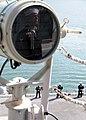 US Navy 110414-N-RU841-019 Quartermaster 1st Class Raymond Steele mans the rails aboard the forward-deployed amphibious assault ship USS Essex (LHD.jpg