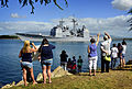 US Navy 110624-N-RI884-057 Friends and family members of Sailors assigned to USS Port Royal (CG 73) wave as the ship departs Joint Base Pearl Harbo.jpg