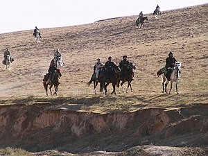 5th Special Forces Group (United States) - Members of ODA 595, part of Task Force Dagger, and Afghan forces ride into northern Afghanistan in October 2001 on horseback.