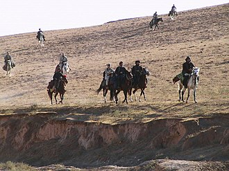 "Special Forces (United States Army) - Special Forces soldiers from Task Force Dagger and Commander Dostum on horseback in the Dari-a-Souf Valley, Afghanistan, circa October 2001—celebrated in the movie ""12 Strong"""