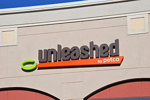 Petco - Sign on an Unleashed store that opened in Oregon in 2013