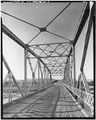 VIEW LOOKING SOUTH THROUGH SUPERSTRUCTURE - Cheyenne River Bridge, County Road 46, Lance Creek, Niobrara County, WY HAER WYO,14-RIVEW.V,1-3.tif