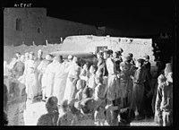 Villagers of el Khadder, listening in to radio of a passing car at night, Oct. 1937 LOC matpc.22264.jpg