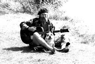 Vivian Stanshall - Vivian with his bulldog Bones, towpath, Shepperton, England, 1980
