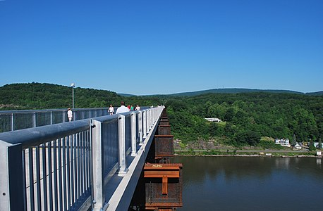 The Poughkeepsie Railroad Bridge in New York, United States, after years of misuse and neglect, was transformed into a pedestrian walkway in 2009 and spans the Hudson River.
