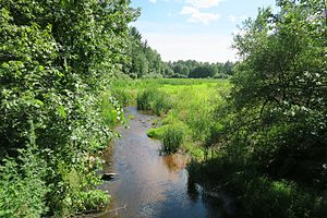 Wekepeke - Wekepeke Brook flowing out of Bartlett Pond in Lancaster