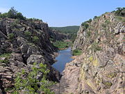 A river carves a canyon in the Wichita Mountains.