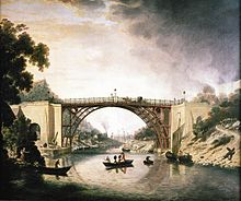 A painting of the bridge, from mid-river, in the picturesque style of the period. Smoking furnaces can be seen in the distance and a Severn trow is alongside the bridge. Two wealthy coaches are visible, as are a well-dressed party of sightseers in a small boat. The bridge is rust-red in colour, suggesting that it was unpainted.