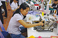 Woman check her sewing machine in Vietnam.jpg
