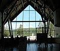 Yellowstone N.P., Old Faithful Ed. Center and Old Faithful 9-2011 (6911238731).jpg