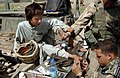 Young Afghan boy receiving medical treatment by US specialists.jpg
