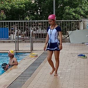 Young woman wearing body-length swimsuit in Pearl River Swimming Pool.jpg