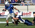 Zack Follett tackles Chad Hall at 2007 Armed Forces Bowl.JPG