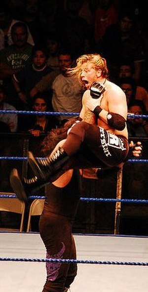 Chokeslam - The Undertaker performing a one-handed chokeslam on Curt Hawkins